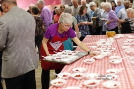 Jan Clayton serving strawberry shortcake.