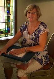 Barbara Grignon resupplying the children's Sabbath boxes.