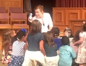 Pastor Kara telling children's story.