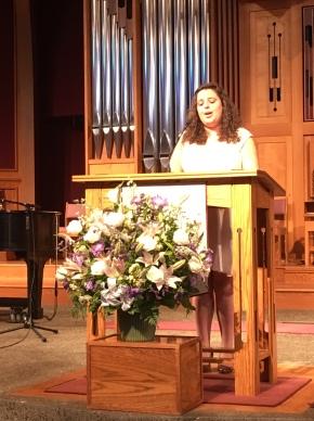 Lisa Riffel leading singing.