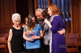 Prayer with Rachel Stanton and family following her baptism.