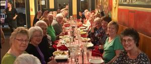 Choir members enjoying food together!